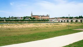 Panoramic view of Gien city from valley of Loire. Travel to France - panoramic view of Gien city from valley of Loire river in summer day Stock Photography