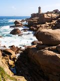 Rocky coast of with lighthouse in Ploumanac'h. Travel to France - rocky coast of English Channel with lighthouse in Ploumanac'h site of Perros-Guirec commune on Stock Photography