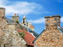 Eglise paroissiale Notre-Dame de Bonne-Nouvelle. Travel to France - typical breton country houses and bell tower of church Eglise paroissiale Notre-Dame de Bonne Royalty Free Stock Photos
