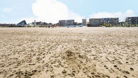 View of sand beach of Le Touquet with apartments. Travel to France - view of sand beach of Le Touquet with apartments (Le Touquet-Paris-Plage) on coast of Royalty Free Stock Images