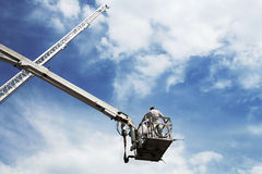 Travel to heavens. Inspectors check serviceability of fire ladders Royalty Free Stock Images
