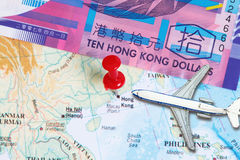 Travel to Hongkong. Concept- with toy airplane and a map showing Hongkong royalty free stock image