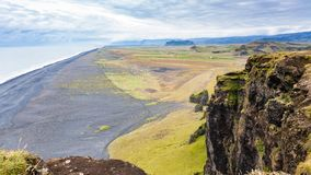 View of Solheimafjara beach from Dyrholaey cliff. Travel to Iceland - above view of Solheimafjara beach from Dyrholaey cliff near Vik I Myrdal village on stock photo