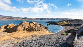 Black beach of Kleifarvatn lake in Iceland Stock Images