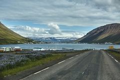 A mountain road to the town of Isafjordur and a view of the fjord Stock Image