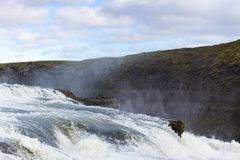 View of Gullfoss waterfall close up in autumn. Travel to Iceland - view of Gullfoss waterfall close up on Olfusa river canyon in autumn Stock Image