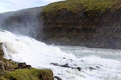 View of Gullfoss waterfall current from canyon. Travel to Iceland - view of Gullfoss waterfall current from canyon edge in autumn Stock Photo
