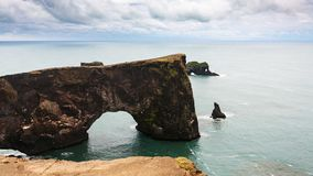 View of stone arch on Dyrholaey cape in Iceland. Travel to Iceland - view of stone arch on Dyrholaey cape near Vik I Myrdal village on Atlantic South Coast in stock images
