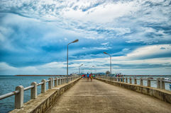 Travel to island. A bridge to the sea and island beyond Royalty Free Stock Image