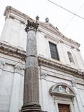 Column and Basilica di Sant'Alessandro in Colonna. Travel to Italy - column and church Basilica di Sant'Alessandro in Colonna on street Via Sant'Alessandro in royalty free stock image