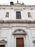 Front view Basilica di Sant'Alessandro in Colonna. Travel to Italy - front view of church Basilica di Sant'Alessandro in Colonna on street Via Sant'Alessandro in royalty free stock photography