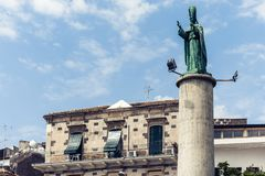 Travel to Italy -  historical street of Acitrezza, Catania, Sicily, facade of old buildings with monument of San Mauro.  stock photography