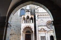 View Basilica from arch of Palazzo della Ragione. Travel to Italy - view of Giovanni da Campione porch of Basilica of Santa Maria Maggiore and Cappella Colleoni stock photos