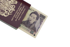 Travel to Japan. A passport with some Japanese money sticking out. They have been isolated from the background. Ideal for travel related to Japan royalty free stock images
