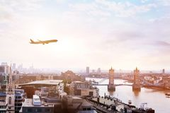 Travel to London by flight, airplane in the sky above Europe. Travel to London by flight, airplane the sky over Tower Bridge stock images