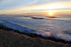 Travel to magnificent colorful scenery of atlantic ocean with breaking waves with mountain la rhune in sunset, capbreton, france Royalty Free Stock Photos