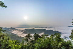 Morning mist and mountains. Travel to the mountains, fog, many people to see the beautiful scenery. At the top of the mountain Stock Photography