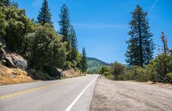 Travel to the National Parks of the United States. Entry to Yosemite National Park. Trip to the Yosemite National Park. A winding road Stock Photos