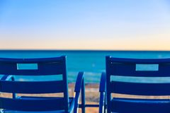 Travel to Nice. Blue chairs. royalty free stock photo