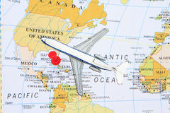 Travel to North America. Toy airplane and push pin to North America map royalty free stock image