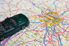 Travel to paris. A toy car on a road map near Paris Royalty Free Stock Photography