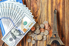 Travel to Paris, France concept with Eiffel Tower souvenir. Tourism, planning summer vacation, budget trip. Saving money for trip. Royalty Free Stock Images