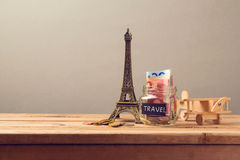 Travel to Paris, France concept with Eiffel Tower souvenir and wooden airplane toy. Planning summer vacation. Money budget trip concept Stock Image