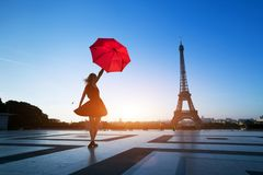 Beautiful girl with red umbrella near Eiffel Tower, Paris stock images