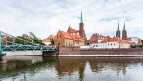Tumski Bridge and Collegiate Church in Wroclaw Royalty Free Stock Image