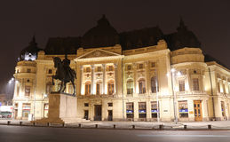 Travel Romania: Central University Library. The Central University Library is located in central Bucharest. Romania.The statue belongs to Carol I, first king of royalty free stock photo