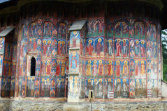 Travel to Romania: Moldovita mural paintings. One of Romanias most beautiful places the Moldovita monastery is  also a featuring in the UNESCO world heritage. It Stock Photos