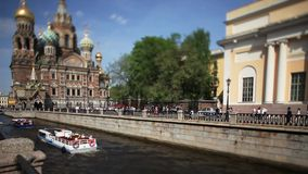 Travel to Russia St. Petersburg in the summer. St. Petersburg  view of the Griboyedov Canal and Cathedral of the Resurrection Film Tilt stock video