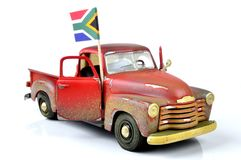 Travel to South Africa. An old dirty, dilapidated truck with a South African flag.  Travel concept, to South Africa Royalty Free Stock Photos