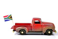 Travel to South Africa. An old dirty, dilapidated truck with a South African flag.  Travel concept, to South Africa Royalty Free Stock Image