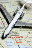 Travel to Thailand. Concept - with toy airplane in the map focus on Bangkok royalty free stock photo