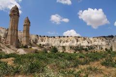 Travel to visit wonderful serie of troglodytes in love valley in blue sky, cappadocia, turkey Royalty Free Stock Photo