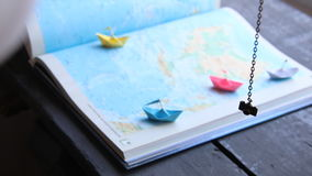 Travel to World. Tourism. Paper boats on the map stock video