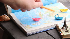 Travel to World. Tourism. Paper boats on the map and the Eiffel Tower. stock footage