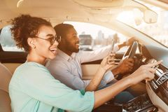 African-American Couple Using Navigator System, Driving Car royalty free stock images
