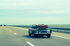 Travel together by car, retro cabriolet, vintage luggage Stock Photos