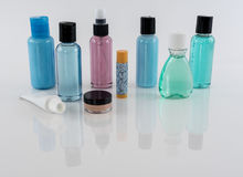 Travel Toiletries on Reflective Surface royalty free stock image