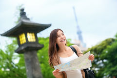 Travel in Tokyo - Asian tourist woman with map Stock Photography