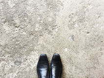 Travel. Top view of Black Business Shoes standing on the cement floor , space for text Stock Photos