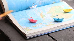 Travel, tour or tourism idea, paper boats and map. Travel and tourism concept, paper boats on the map stock video footage