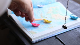 Travel or tour, vacation idea. Travel and tourism concept, paper boats on the map stock video