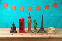 Travel and tourism background with souvenirs from around the world stock photos