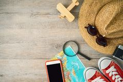 Travel and tourism background with vacation items on wooden table royalty free stock photography
