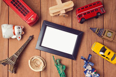 Travel and tourism concept with frame mock up template and souvenirs from around the world. Royalty Free Stock Photo
