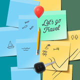 Travel and tourism concept. Lets go travel text on the post it notes, travel doodles, key, pencil Royalty Free Stock Image