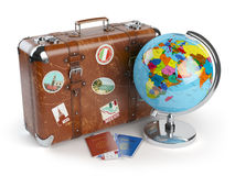 Travel or tourism concept. Old suitcase with stickers, globe  Royalty Free Stock Photos